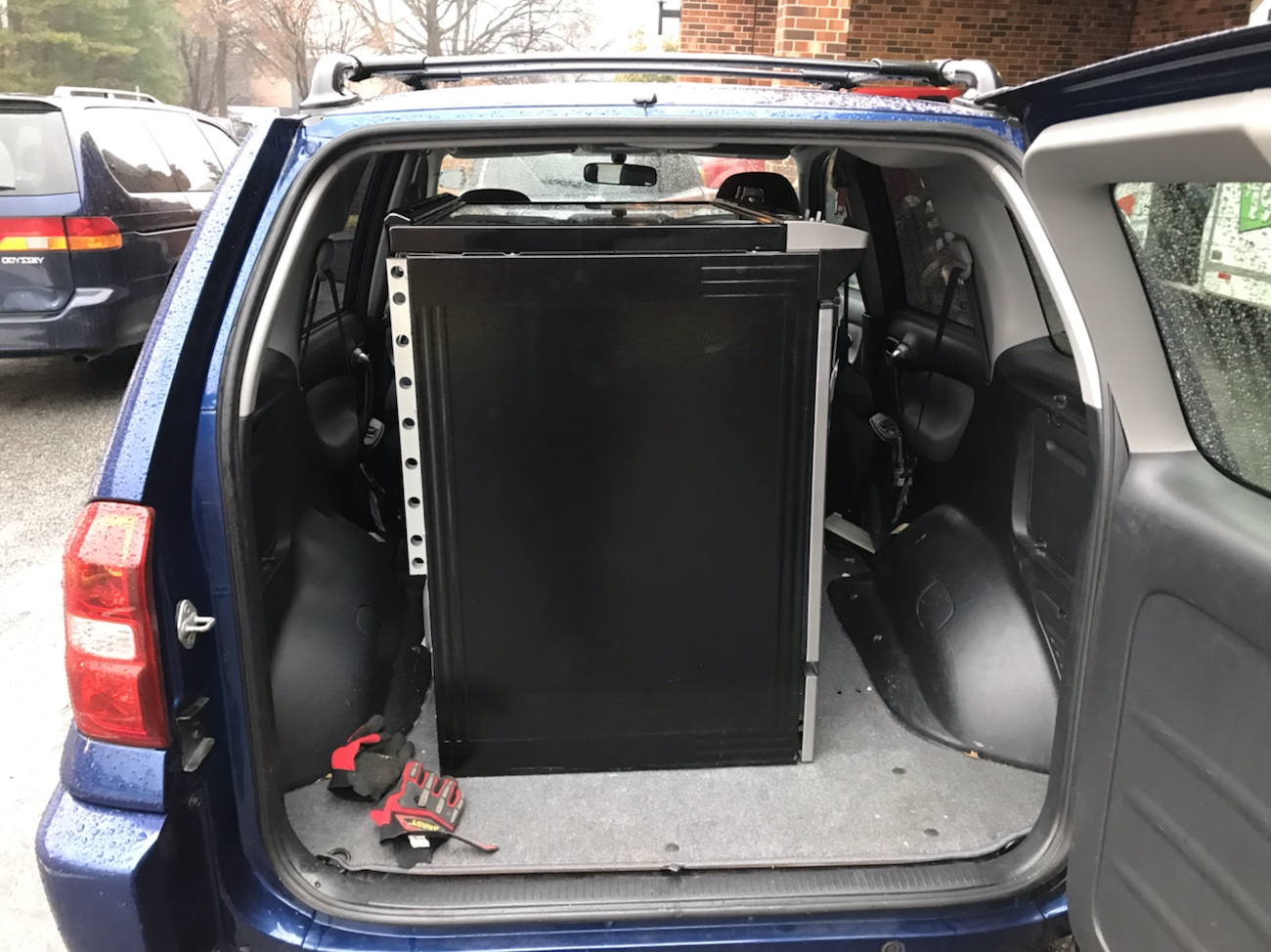 Toyota RAV4 with kitchen stove in back